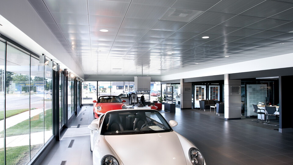 Porsche of The Motor City, Melissa Reis, Porsche Corporate Architecture Specialist, Porsche Cars North America, Inc., Rodica Phillips, CHMP Associates, John Edmonds Demolition and Construction, Dian Selleck-Wilson, Selleck Architectural Sales Inc., SpanAir Clip-In Perforated Metal Ceilings Panels, Showroom, Bochsler Creative Solutions
