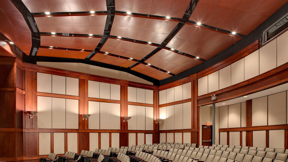Dannelly Composite Operations and Training Facility's Auditorium, Alabama Army and National Air Guard, Seay-Seay & Litchfield Architects, Bear Brothers, Inc., E&E Acoustical and Drywall, Inc., SpanAir Torsion Spring Panels, Infinity Perimeter Trim, Custom WoodScenes, Walnut Painted Finish, Government, Curt Ullery
